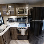 The 36VBDS kitchen features a residential 16 CU FT refrigerator, XL window, and stainless steel roll-up sink cover.