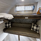 The bunk room in the 36VBDS includes L shaped Versa-Bunks, Versa-Queen, and exterior storage access.