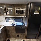 The image shown is of the 263BHXL's kitchen and the XL kitchen window, stainless steel roll-up sink cover, and 11 CU FT Frost Free Referigerator. May Show Optional Features. Features and Options Subject to Change Without Notice.