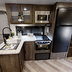 The 29VBUD kitchen features an 11 CU FT Frost Free referigerator, XL window, and stainless steel roll-up sink cover. May Show Optional Features. Features and Options Subject to Change Without Notice.