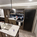 The 32RET kitchen includes an 11 CU FT Frost Free refrigerator, XL window, island, and stainless steel roll-up sink cover. May Show Optional Features. Features and Options Subject to Change Without Notice.