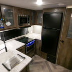The 27RK kitchen also has a XL window, cabinet storage, and stainless steel roll-up sink cover. May Show Optional Features. Features and Options Subject to Change Without Notice.