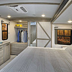 270FKS Bedroom Showing Bed Slide-Out, Dresser and Large Closet at the Rear of the RV May Show Optional Features. Features and Options Subject to Change Without Notice.