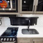 Kitchen sink and range May Show Optional Features. Features and Options Subject to Change Without Notice.