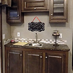 Hutch with Wet Bar and Sink May Show Optional Features. Features and Options Subject to Change Without Notice.