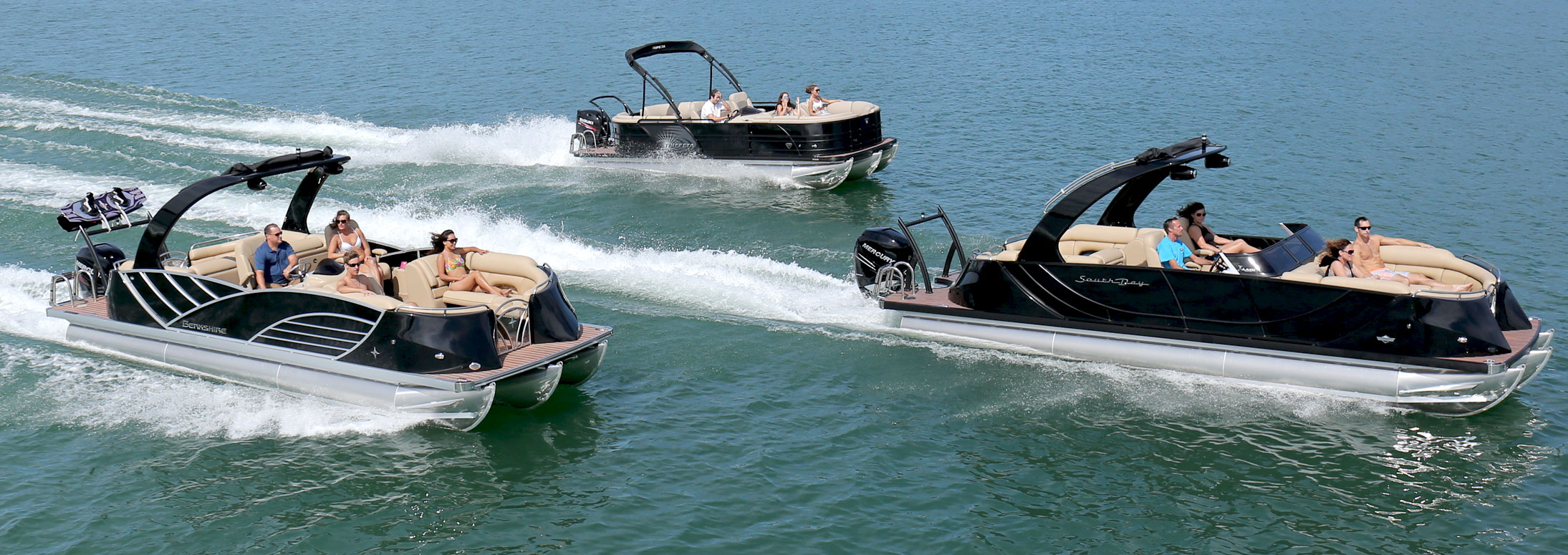 three pontoon boats out on the lake