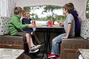 children at RV table