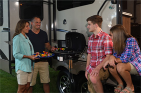 Family cooking on extior RV grill
